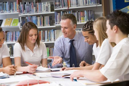 uniformly dressed: Students and teacher in a study group collaborating Stock Photo