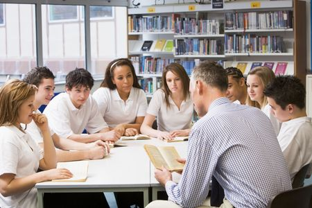 instructing: Students and teacher in a study group collaborating Stock Photo