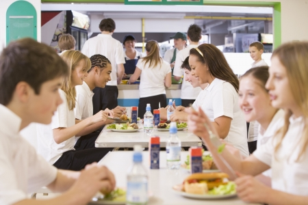 Students having lunch in dining hall photo