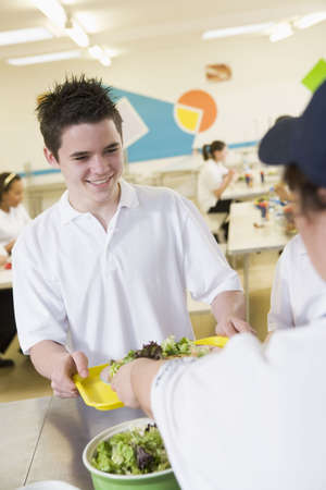 school friends: Student having lunch in dining hall Stock Photo