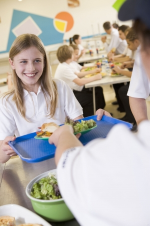 Student having lunch in dining hall Stock Photo - 3204090