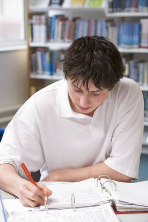 Student writing and studying Stock Photo - 3204111