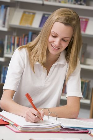 Student writing and studying Stock Photo - 3204196