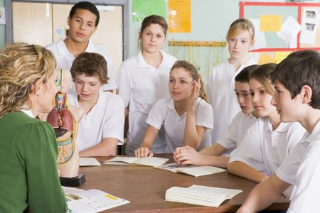 Students receiving a biology lesson in classroom photo