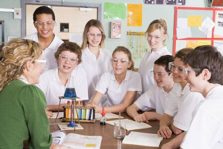 uniformly dressed: Students receiving chemistry lesson in classroom