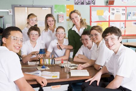 chemistry lesson: Students receiving chemistry lesson in classroom
