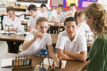 science lab: Students performing science experiments in classroom
