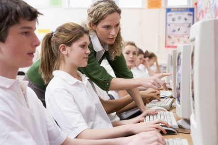 faculty: Students working on computer workstations with teacher