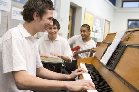 Student musicians practising in classroom photo