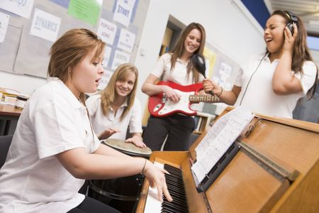 school band: Student musicians practising in classroom