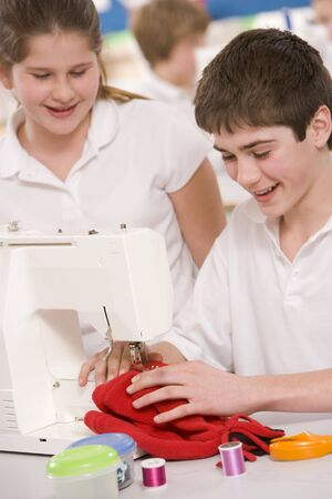 tweeny: Male and female student using sewing machine