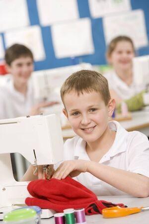 sewing supplies: Male student using sewing machine Stock Photo