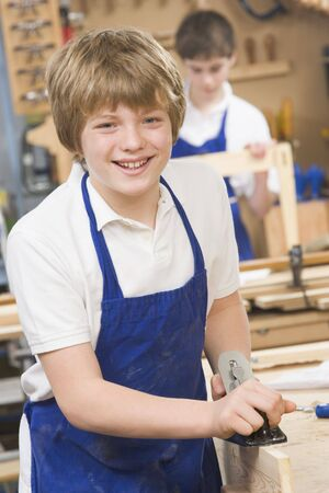uniformly dressed: Male student learning woodworking