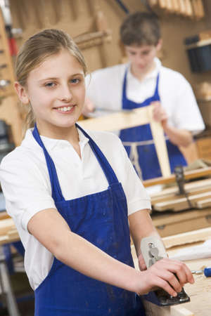 only boys: Female student learning woodworking