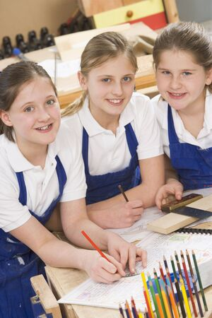 uniformly dressed: Female students learning woodworking Stock Photo