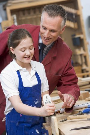 uniformly dressed: Female student learning woodworking