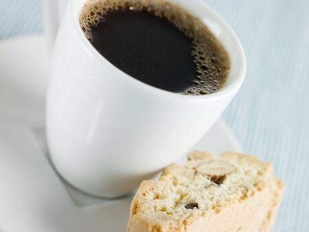 offset up: Cup of Espresso Coffee with Hazelnut Biscotti