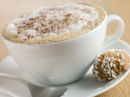 offset angles: Cup of Cappucino with an Amaretti Biscuit
