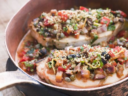 крупные планы: Baked Sicilian Swordfish in a Copper pan