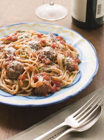 Spaghetti Meatballs in Tomato sauce with Parmesan photo