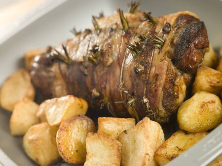 Roast Leg of Lamb Studded with Garlic and Rosemary and Roast Potatoes photo