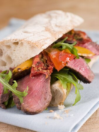 крупные планы: Sirloin Steak and Roasted Pepper Ciabatta Sandwich Фото со стока