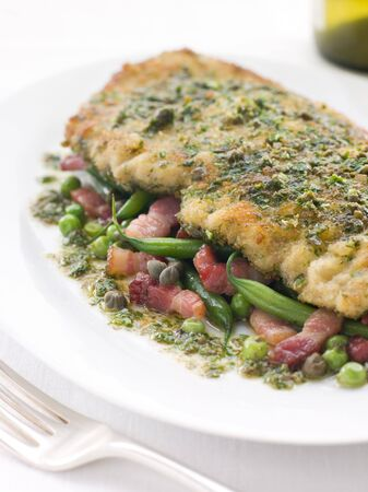Cotoletta of Veal with Green Beans Peas and Pancetta photo