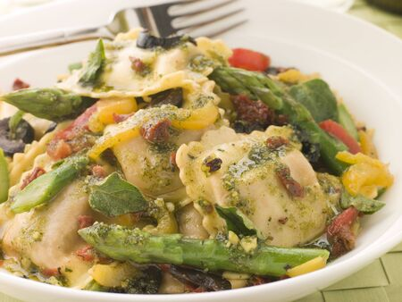 Roasted Vegetable Ravioli with Pesto Dressing Sun Blushed Tomatoes and Asparagus photo