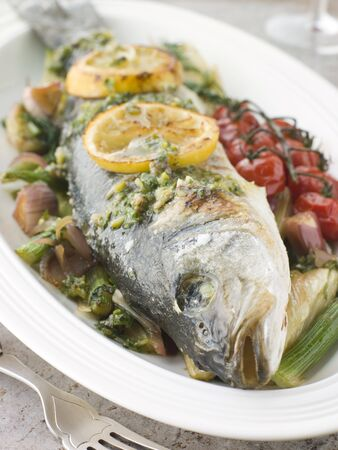 edible fish: Whole Roasted Sea Bass with Fennel Lemon Cherry Vine Tomatoes and Salsa Verde