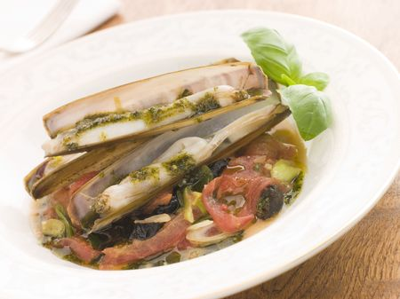 Razor Clams with Stewed Tomatoes Garlic and Olives photo