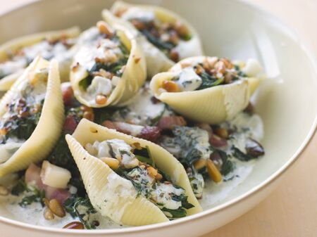 Conchiglioni pasta shells with Spinach Pancetta Pine Nuts and Gorgonzola Cream photo