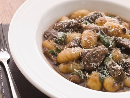 gnocchi: Oxtail Braised in Red Wine with Basil Gnocchi and Parmesan Cheese
