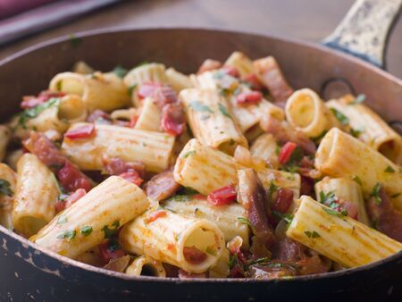Pan of Rigatoni Pasta with Tomato and Pancetta Sauce photo