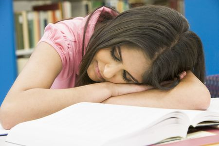 student sleeping in library photo