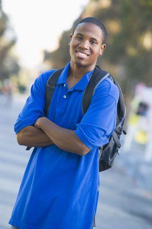 knap sacks: Man standing outdoors smiling (selective focus)