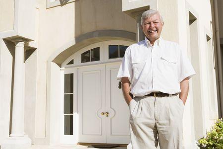 Senior man standing outside his home Stock Photo - 3176986
