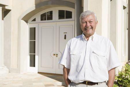 Senior man standing outside his home Stock Photo - 3176985
