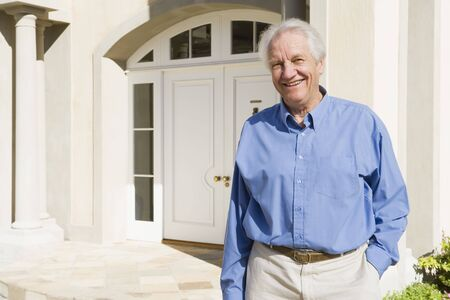 golden years series: Senior man standing outside his home Stock Photo