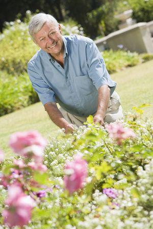 offset views: Senior man in a flower garden