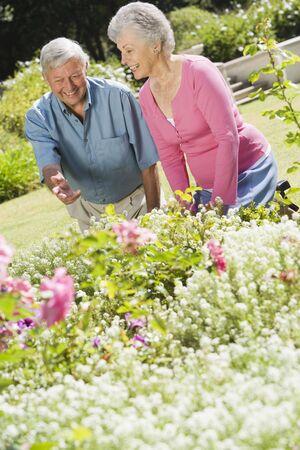 golden years series: Senior couple in a flower garden