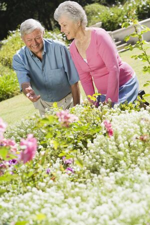 offset angles: Senior couple in a flower garden