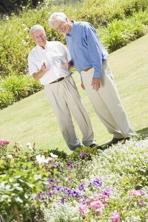 Two senior men in a flower garden photo