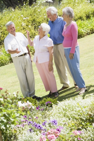 Two senior couples in a flower garden photo