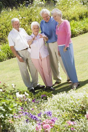 Two senior couples in a flower garden Stock Photo - 3177540