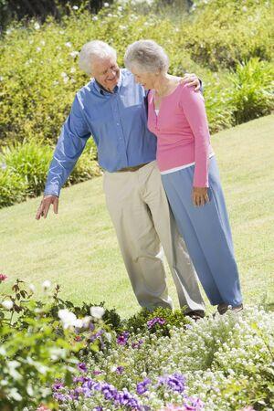 Senior couple in a flower garden Stock Photo - 3177591