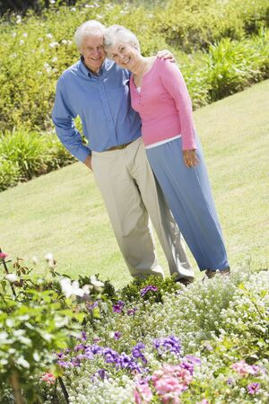 Senior couple in a flower garden photo