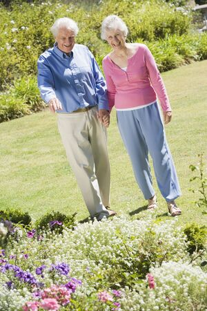 Senior couple in a flower garden photo