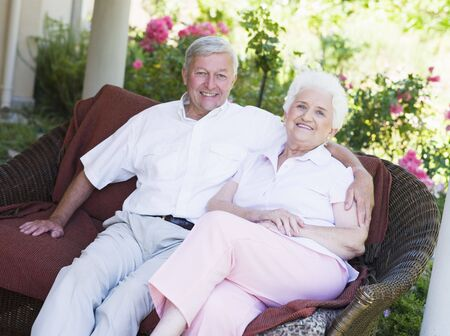 Senior couple sitting outdoors Stock Photo - 3177572