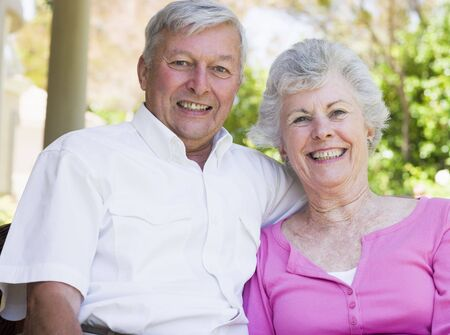 Senior couple sitting outdoors photo