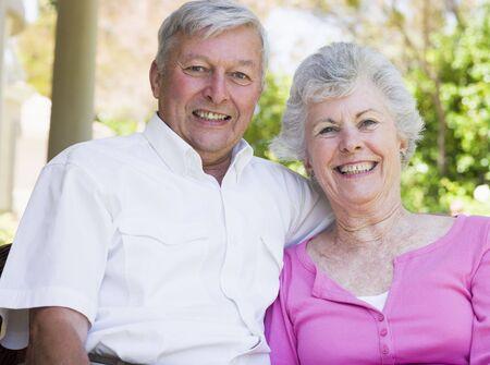 Senior couple sitting outdoors photo